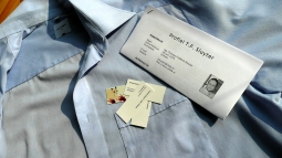 A blouse, my resume and some calling cards.